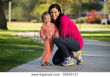 Beautiful Mother And Daughter Posing In The Neighborhood