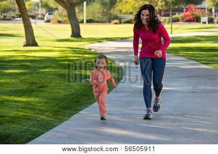 Beautiful Mother And Daughter Running In The Neighborhood