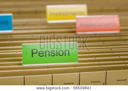 A hanging file folder labeled with Pension