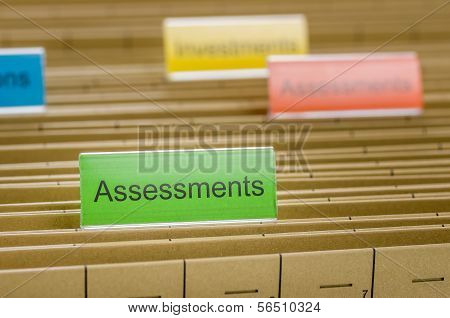 A hanging file folder labeled with Assessments