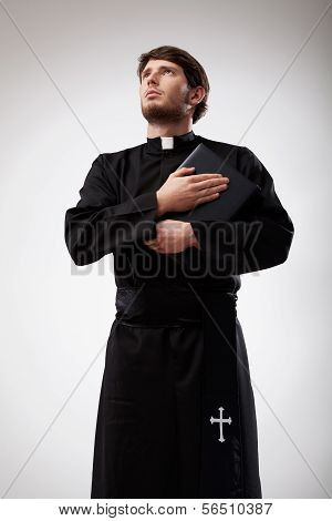 Young Priest Holding His Prayer Book