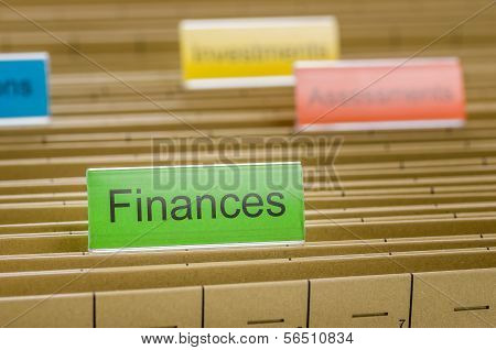 A hanging file folder labeled with Finances