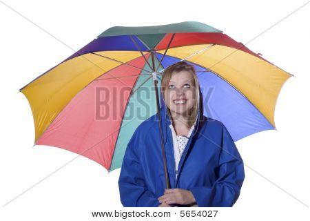 Women With Umbrella In A Blue Rain Coat