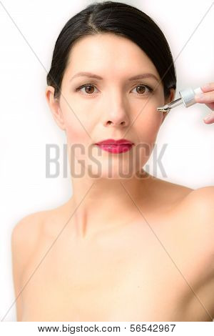 Topless Young Woman Holding A Dropper
