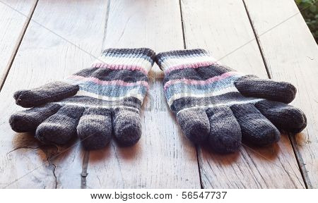Knit Winter Gloves On Wood Table