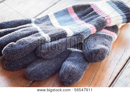 Knit Wool Gloves On Wood Table