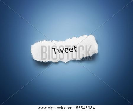 Text tweet on white piece of paper