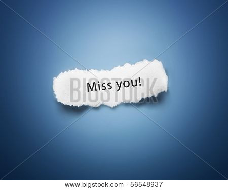 Text Miss you on white piece of paper