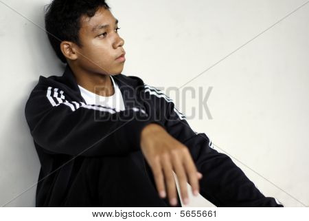 Casual asian man slouched