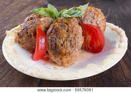 Lula Lamb And Tomatoes On A Plate