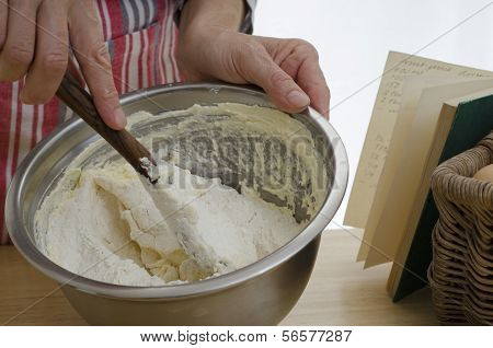 Hands Mixing A Cake