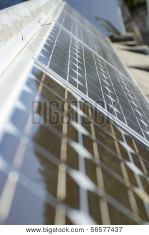 Closeup Of Some Solar Panels Reflecting Surroundings