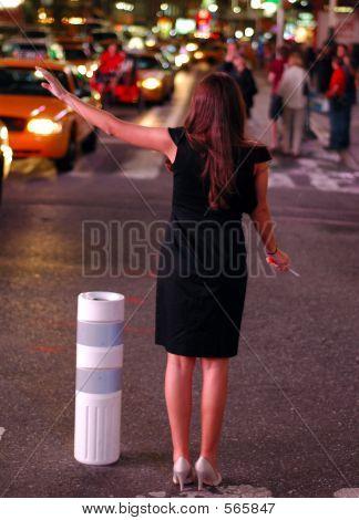 Black Dress Hails A Cab