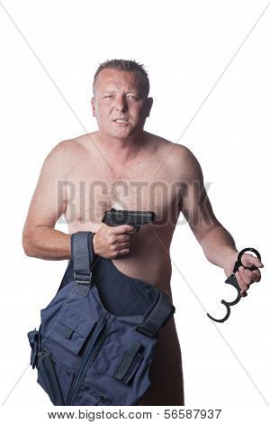 Man With Kevlar Vest, Hand Cuffs And Gun