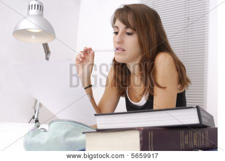 Young Female Student At Her Desk