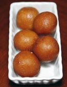 foto of mishti  - indian fresh and hot sweets for desert - JPG