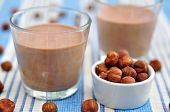 stock photo of hazelnut  - Home made Chocolate hazelnut mousse with cream - JPG