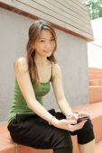 pic of handphone  - Asian Youth Culture Teenager with a Handphone - JPG