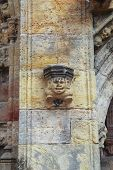 picture of rosslyn  - Laughing figure on wall of Rosslyn Chapel in Scotland - JPG