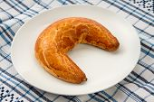 foto of crescent-shaped  - Traditional Hungarian folk xmas poppy crescent shape sweet cake  - JPG