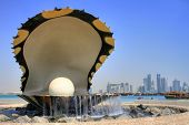 image of qatar  - Monument symbolizing an oyster with skyline of Doha city in the background - JPG