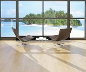 Two lounge chairs against huge window with seascape view