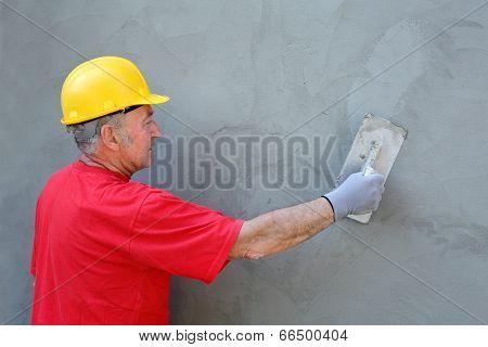 Worker Making Facade