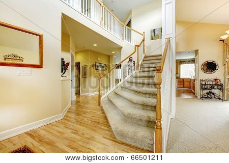 Elegant Staircase With White Railings In Modern House
