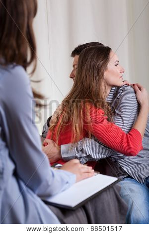 Hugging Couple At Psychotherapy
