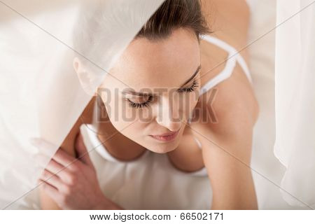 Sensual Woman Lying In Canopy Bed