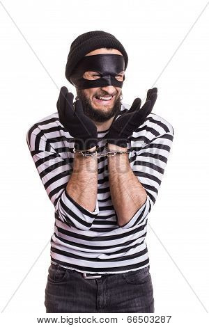 Sad thief with handcuffs