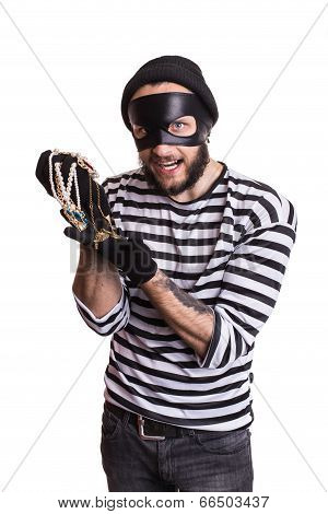 Happy thief holding stolen jewelry
