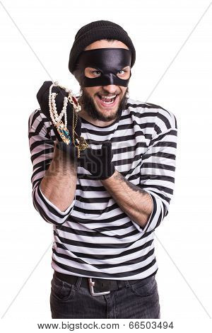Happy robber holding stolen jewelry