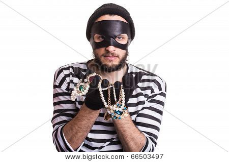 Thief showing stolen jewelry