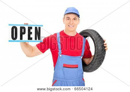 Male mechanic holding an open sign isolated on white background