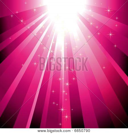 Sparkling stars descending on magenta light burst