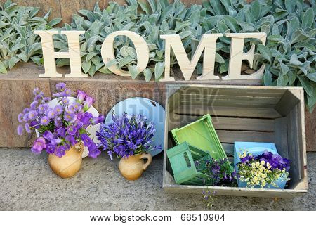 Garden decoration with wildflowers and decorative letters, outdoors