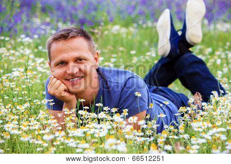 Portrait Of A Man In A Flowery Meadow.
