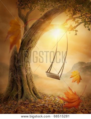 Old swing hanging from a large tree