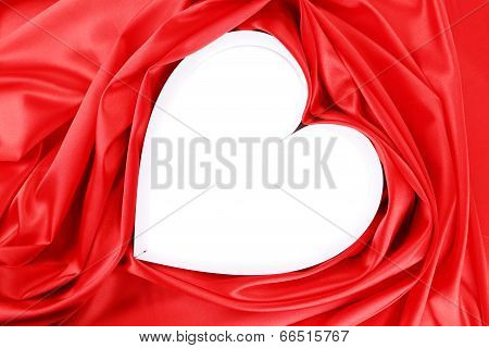 Paper heart in red satin.