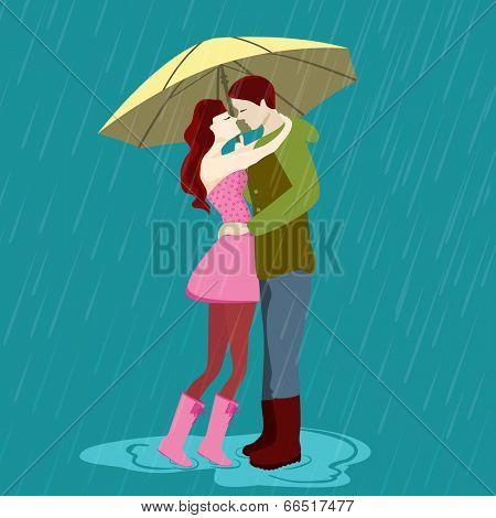 Young couple kissing under the umbrella, romantic monsoon season background.