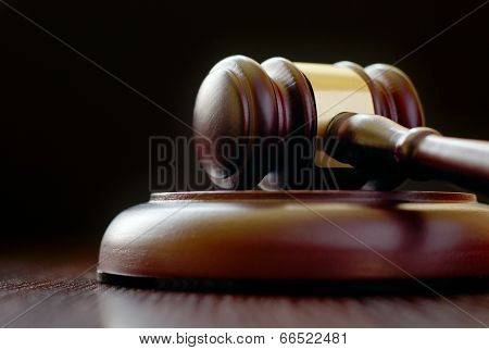 Gavel Laying On Its Side On Sounding Block
