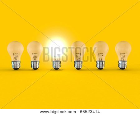 A line of lightbulbs with only one lit