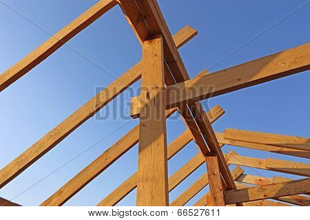 Installation Of Wooden Beams At Construction Of Frame House