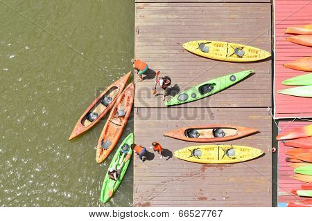 Colorful kayaks docked - as seen from above
