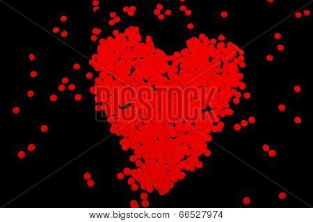 Red heart made of papers from paper puncher