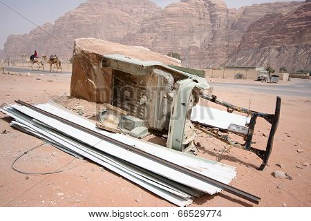 Chassis of a jeep and camels in the back - scene from a desert in Jordan