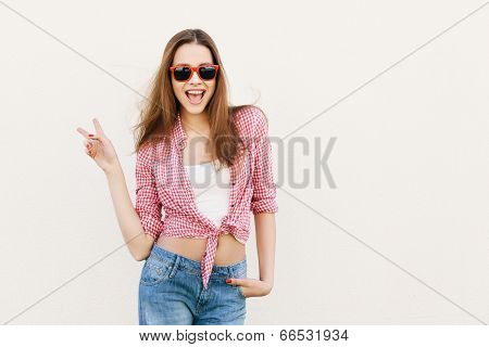 Young Woman Posing By The Wall.