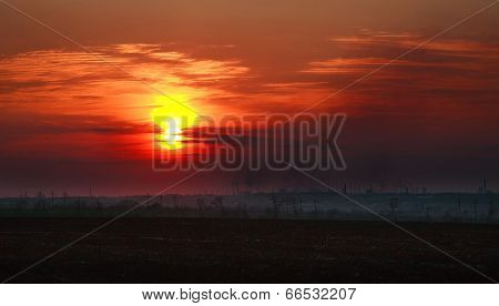 Industrial City In The Dirty Smoke On The Background Of Dramatic Sunset Sky, Concept Pollution Of Th