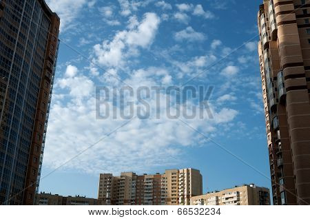 Blue Sky With Small Clouds Between Homes